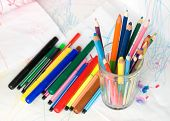 stock photo of dessin  - Colored pencils in a glass on a child - JPG