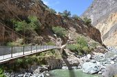 Bridge Crossing The River On Bottom Of Colca Canyon, Peru poster