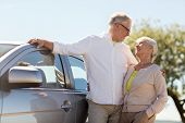 road trip, travel and old people concept - happy senior couple with car in summer poster
