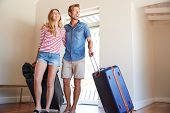 Couple Arriving At Summer Vacation Rental poster