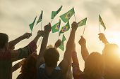 Rising Up Brazil Flags. Crowd Of People Holding Brazilian Flags, Back View. poster