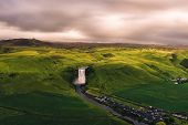 Aerial View Of The Skogafoss Waterfall In Southern Iceland At Sunset Surrounded By Beautiful Iceland poster