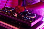 Dj Playing Music.midi Controller Turntable.new Digital Technology For Mixing Audio Tracks.sound Mixe poster
