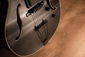 Black Jazz Archtop Guitar With F-holes Close Shot. Hollow Steel-stringed Acoustic Or Semiacoustic Gu poster