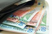stock photo of ringgit  - close up malaysian ringgit inside a wallet - JPG
