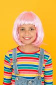 New Smile New Look. Little Girl Smile In Short Pink Hair Wig. Happy Child Smile Yellow Background. S poster