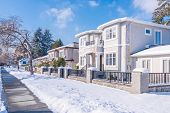 A perfect neighbourhood. Houses in suburb at Winter in the north America. Luxury houses covered nice poster