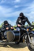 pic of sidecar  - Two armed men riding a motorcycle with a sidecar - JPG