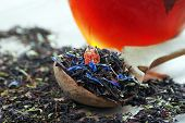 Blended Tea. Black Tea With Dry Flower Petals And Fruits. Dry Black Tea Leaves In A Wooden Spoon And poster