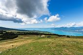 Aerial View Of The Lake Garda With Green Pastures In Italian Alps, View From The Monte Baldo. Veneto poster