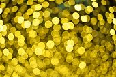 Defocused Bokeh Lights. Festive Yellow Lights Bokeh Background poster