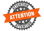 Attention Grunge Stamp With Orange Band. Attention poster