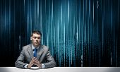 Man With Folded Hands Sitting At Desk. Internet Manager Wears Business Suit And Tie On Abstract Matr poster