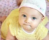 pic of cute little girl  - closeup portrait of beautiful funny girl with blue eyes in pretty hat looking in camera - JPG
