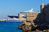 Bow Of Large Cruise Ship In The Port Of The Ancient City, Protruding From Behind The Fortress And To poster