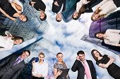 Collage Of Business People Over Cityscape Background From Bottom View. poster