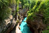 Mountain Gorge & River. Beautiful Landscape Featuring Mountain River Sandwiched Between Towering Cli poster