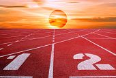 Track Running, Track Sunset Red, Running Track With Lanes Over Sky And Clouds poster