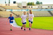 Child Running In Stadium. Kids Run On Outdoor Track. Healthy Sport Activity For Children. Little Gir poster