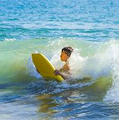 stock photo of papagayo  - boy has fun surfing in the waves