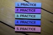 Practice. Practice. Practice. Practice. Practice Text On Sticky Notes Isolated On The Tables poster