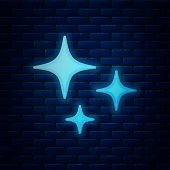Glowing Neon Falling Star Icon Isolated On Brick Wall Background. Shooting Star With Star Trail. Met poster