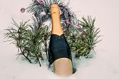 Love, Romance, Holiday, New Year Celebration Concept. Bottle Of White Wine Chilled By Snow In Winter poster