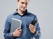 foto of dial pad  - Working handsome man with digital tablet and mobile phone - JPG