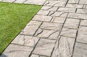 pic of grout  - Details of gray black crafted stone garden tiles floor - JPG