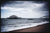 Remains Of West Pier, With Waves Crashing On Shore, Brighton, England, Uk
