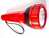 foto of torchlight  - Red Flashlight isolated switch off on white background - JPG