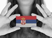 stock photo of serbia  - Woman showing a business card black and white Serbia - JPG