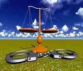 pic of handlock  - Scales of justice and handcuffs concept - JPG