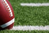 stock photo of hash  - American Football on the Field near the hashmarks - JPG