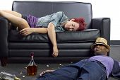 stock photo of underage  - drunken college friends passed out on a couch - JPG