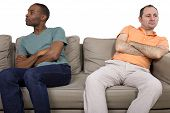 pic of breakup  - interracial gay couple on a white background - JPG