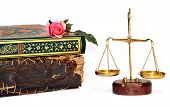 picture of quran  - old book holy quran on rose and justice scales - JPG