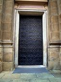 picture of ferrous metal  - background metal door with decorative ornament in an old house - JPG