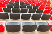 stock photo of grandstand  - Black and red Empty Seats of a grandstand