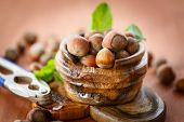 pic of cobnuts  - fresh hazelnuts in the shell on a wooden table - JPG