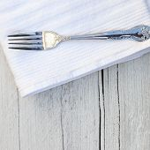 Rustic Place Setting On A Wooden Table