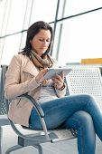 Businesswoman using tablet with internet on the airport