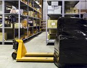 stock photo of picking tray  - Forklift with packed boxes on a large modern warehouse - JPG