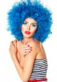 image of wig  - Portrait of a young beautiful girl with bright makeup red lips in blue wig - JPG