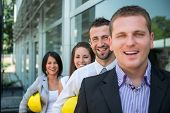 Business people smiling standing in row outdoors