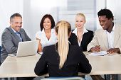 pic of interview  - Portrait Of Female Woman Sitting At Interview