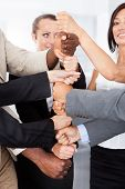Businesspeople Stacking Fist Over Each Other