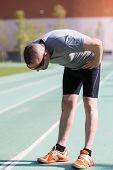 stock photo of fatigue  - Sportsman fatigued after seeing traveled a long distance - JPG
