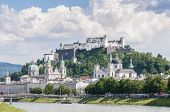 stock photo of mozart  - Salzach river on its way through Salzburg city Austria - JPG