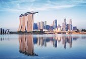 stock photo of hsbc  - Singapore skyline at sunrise - JPG